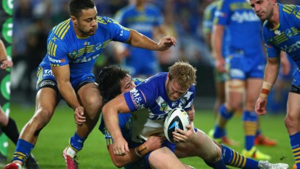 Touchdown: Parramatta talisman Jarryd Hayne looks on as Aiden Tolman scores for the Bulldogs.