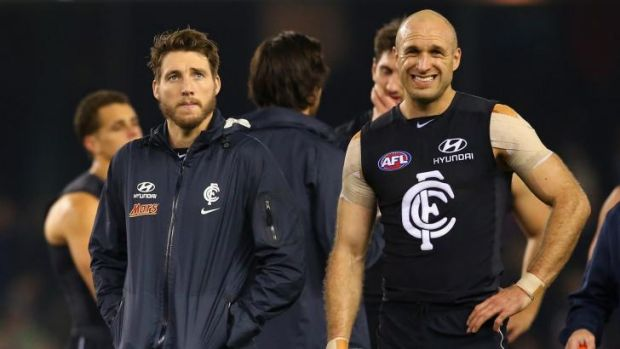 Dale Thomas and Chris Judd of the Blues look dejected after the narrow loss.