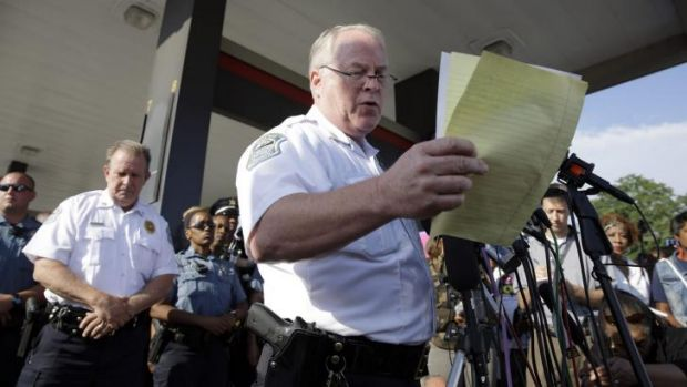 Ferguson Police Chief Thomas Jackson reads a police timeline of events leading up to the police shooting of Michael ...