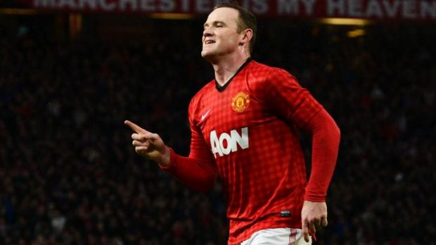 Leading by example: Wayne Rooney will lead Manchester United this season.