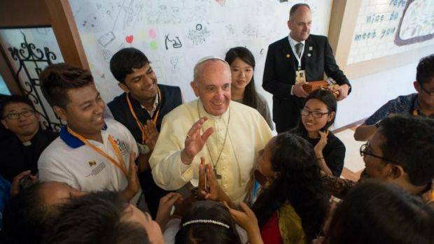 Pope Francis is welcomed by young people at the Major Seminary of Daejeon.