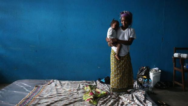 A mother and child in a classroom now used as an Ebola isolation ward in Monrovia, Liberia.