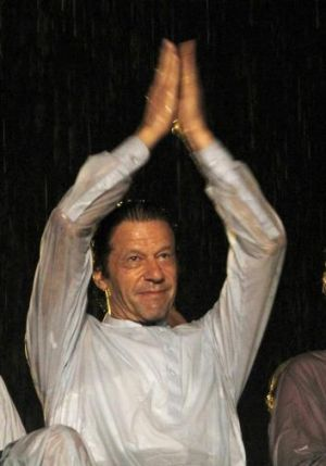 Freedom: Imran Khan applauds supporters during an anti-government rally in Islamabad.
