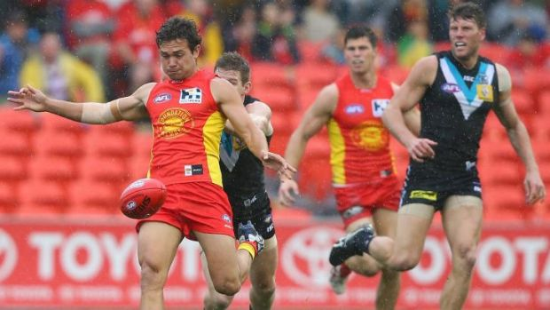Jarrod Harbrow gets boot to ball.