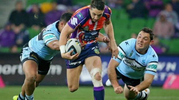 Breaking the line: Billy Slater makes a bust for the Storm.