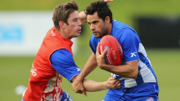 Daniel Wells (right) is tackled by Ryan Bastinac during a North Melbourne training session on Thursday.