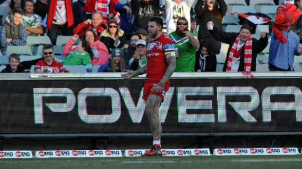Former Raiders player Josh Dugan gets a varied reaction from the crowd after scoring a try.