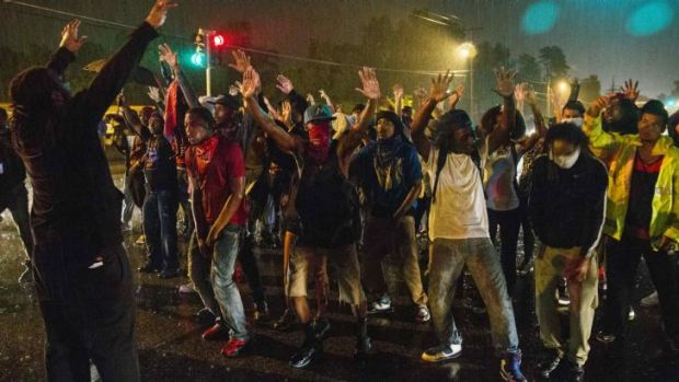 Protesters defied the midnight curfew in Ferguson.