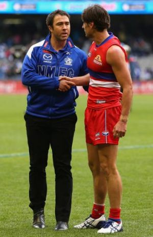 Brad Scott congratulates Ryan Griffen of the Bulldogs who played his 200th game on Sunday.