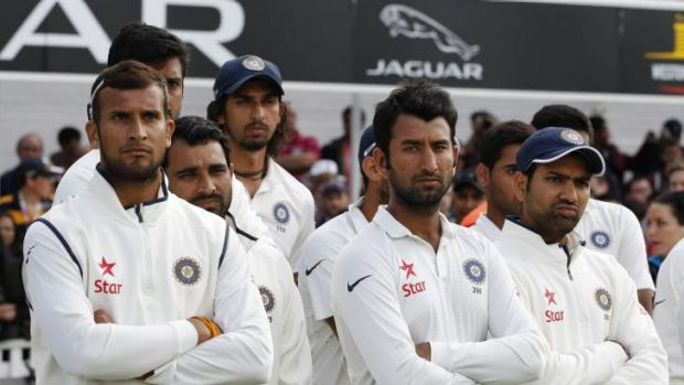 Mercy rule: Indian players downcast after Sunday's capitulation in the fifth Test against England.