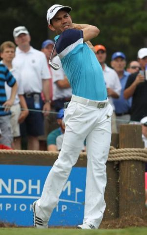 Camilo Villegas of Colombia plays his tee shot on the 16th hole.