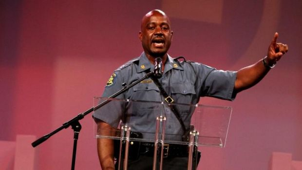 Missouri Highway Patrol Captain Ron Johnson speaks during a service for the family of Michael Brown on Sunday