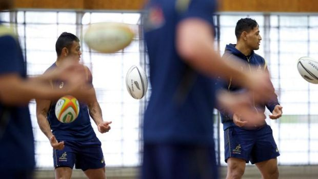 Inside ball: Kurtley Beale and Israel Folau during an indoor training session on Monday.