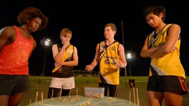 Three's a crowd: Tactics change in a conceptual artwork by Gabrielle de Vietri that creates a round AFL pitch and three ...