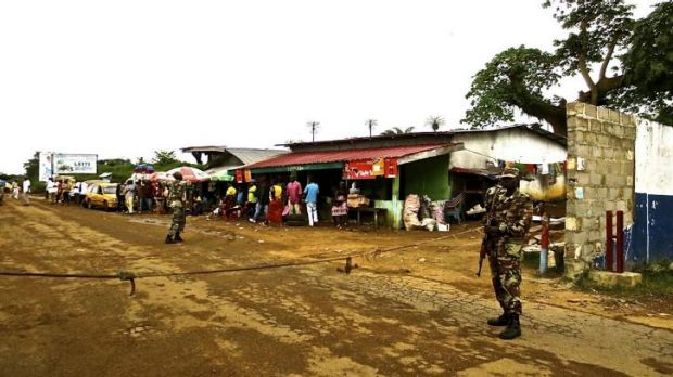 Liberian armed forces monitor a border checkpoint.