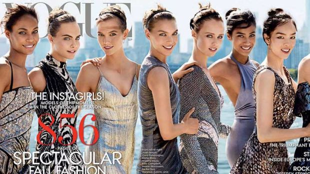 Vogue's 2014 September issue cover. The extended version of the cover features Joan Smalls, Cara Delevingne, Karlie ...