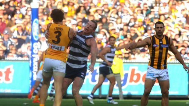 Hawthorn's Jordan Lewis and Geelong's Steve Johnson come to grips.