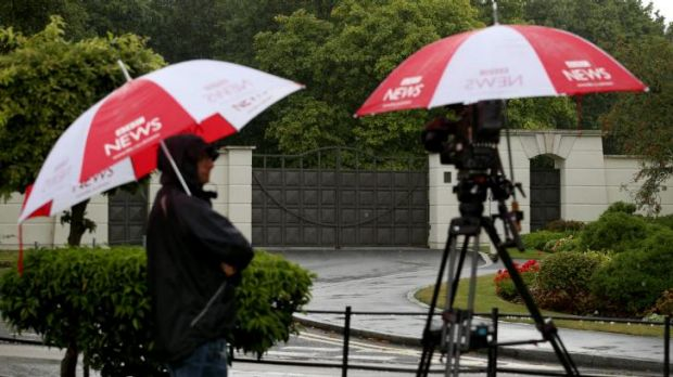 A BBC crew stand in front of the gates of the Charters Estate in Sunningdale, Berkshire, where British entertainer Cliff ...