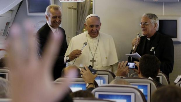 Pope Francis meets the media on the plane back to Rome from Seoul.
