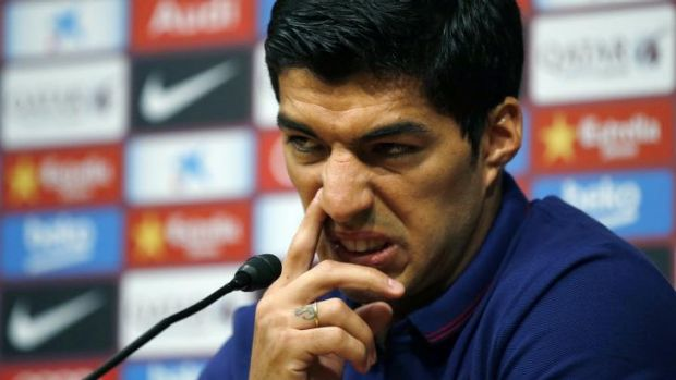 Luis Suarez talks to the media in Barcelona on Tuesday.