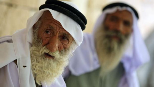 An Iraqi cleric from the Yazidi religious minority sits in the Lalish temple - which is situated in the Shikhan ...
