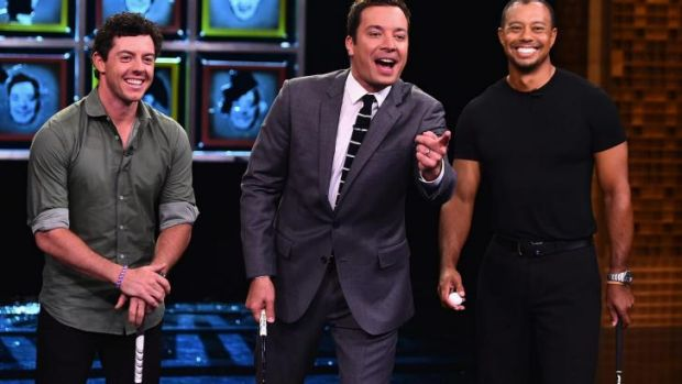 "Rory Mcllroy and Tiger Woods flank US comedian Jimmy Fallon on the set of ""The Tonight Show."""