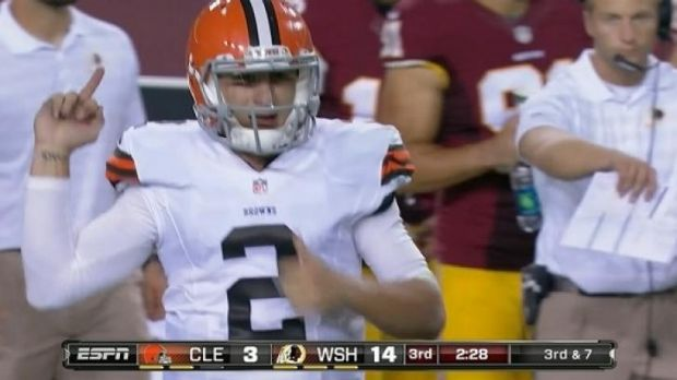 Johnny Manziel appears to make an obscene gesture towards the Redskins bench.