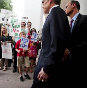 Texas Governor Rick Perry  leaves the Travis County courthouse.