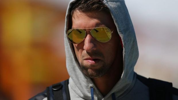Back in the sun: Michael Phelps leaves team training.