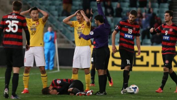 Disbelief: Guangzhou Evergrande react to one of the red cards.