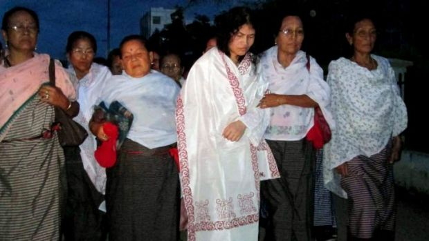 Indian rights activist Irom Sharmila (third from right), who was force-fed during her 14-year hunger strike, is ...