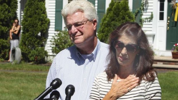 Heartbroken ... Diane and John Foley pay tribute to their son James as they talk to reporters after speaking with US ...