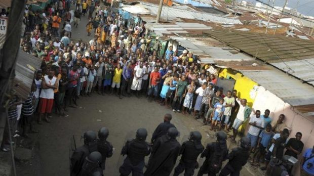 Protesters and security forces face off.