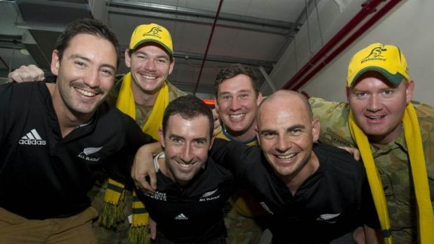 New Zealand and Australian Defence Force supporters of the All Blacks and Wallabies get into the spirit of the game at ...