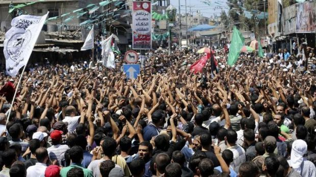 Tens of thousands of Palestinians marched at the funeral of the three Hamas commanders.