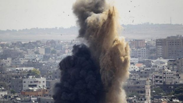 Smoke and sand after an Israeli air strike in Gaza.