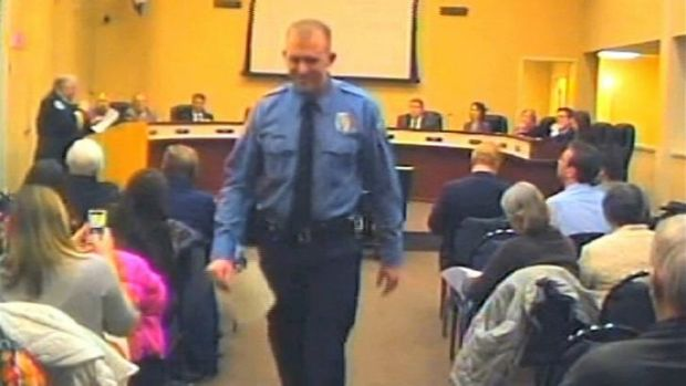 Police officer Darren Wilson attends a city council meeting in Ferguson, Missouri, on February 11.