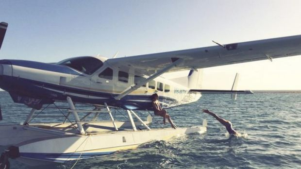 In cruise control: A seaplane lands on the Great Barrier Reef.