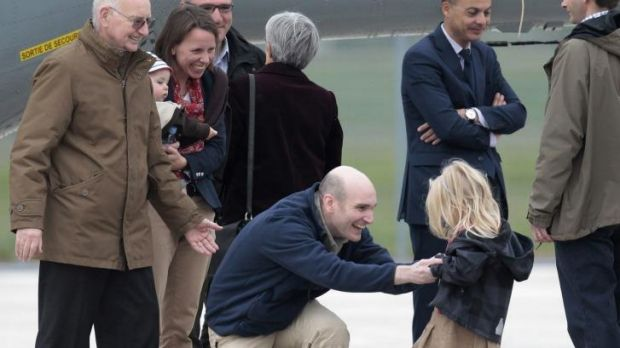 Nicolas Henin, centre, meeting his daughter upon his arrival in France.