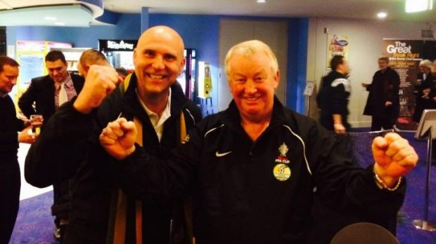 Tuggeranong United president Jon Thiele, left,  and coach Steve Forshaw react after hearing Friday's FFA Cup draw.