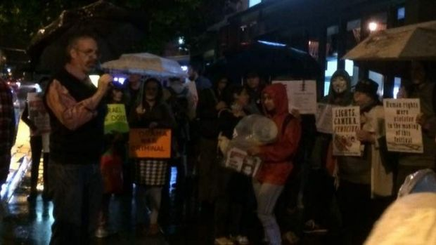 Pro-Palestinian crowds protest outside Palace Centro James Street cinema at New Farm.