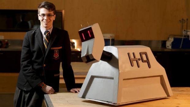 Adam Lloyd alongside his replica K-9 robot.