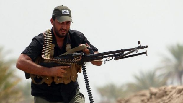 A Shiite Muslim fighter from the Saraya al-Salam  (Peace Brigades), tasked with defending the holy sites of Shiite ...