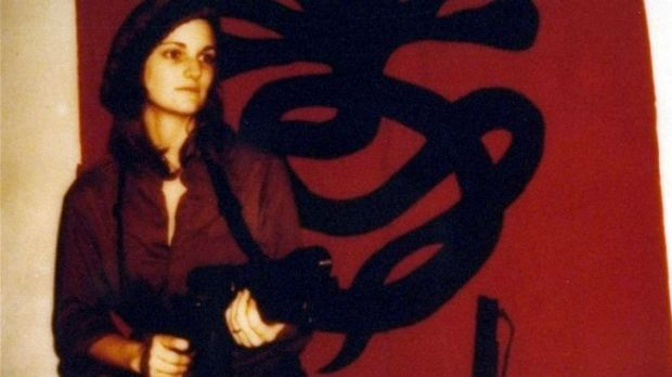 Patty Hearst totes a machine gun in a Symbionese Liberation Army poster.