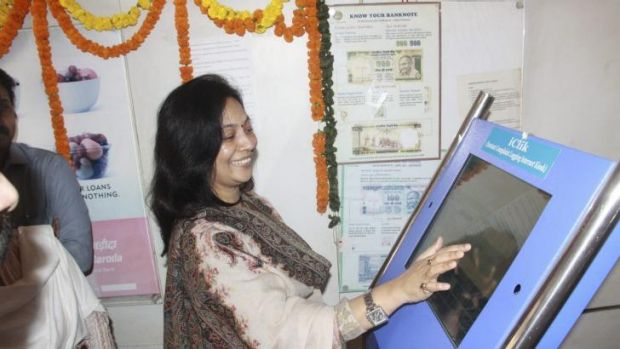Lopamudra Baxipatra, head of the local Women's Commission, inaugurates the iClik kiosk at which women can register ...