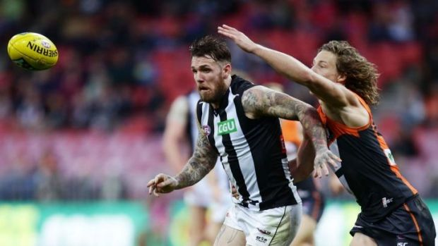 Neck and neck: Magpies midfielder Dane Swan challenges Giants defender Mark Whiley for the ball.