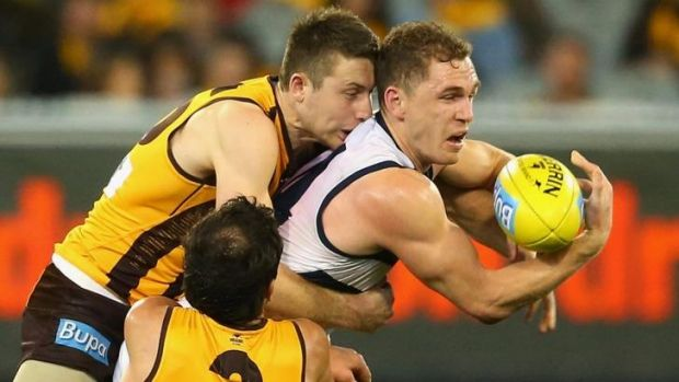 Gotca: Liam Shiels gets a grip on Joel Selwood.
