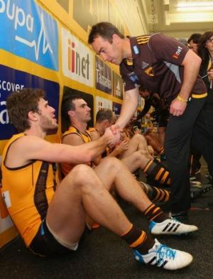 Alastair Clarkson congratulates Grant Birchall on a good game against Geelong.