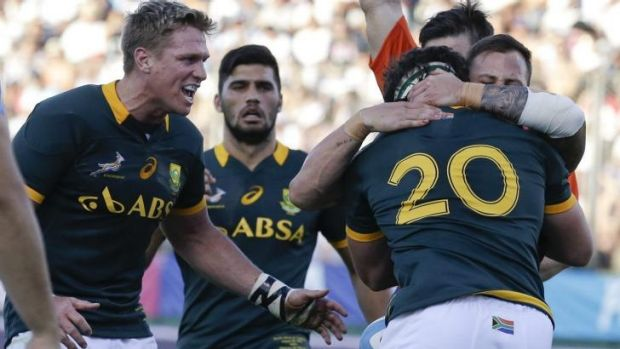 Relief: Marcell Coetzee (20) celebrates scoring a try for South Africa.