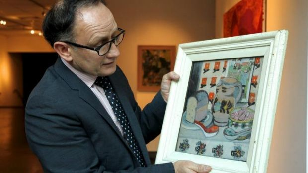 """""""Mystery touch"""": Henry Mulholland with a previously undiscovered Margaret Preston still life that will be auctioned at ..."""